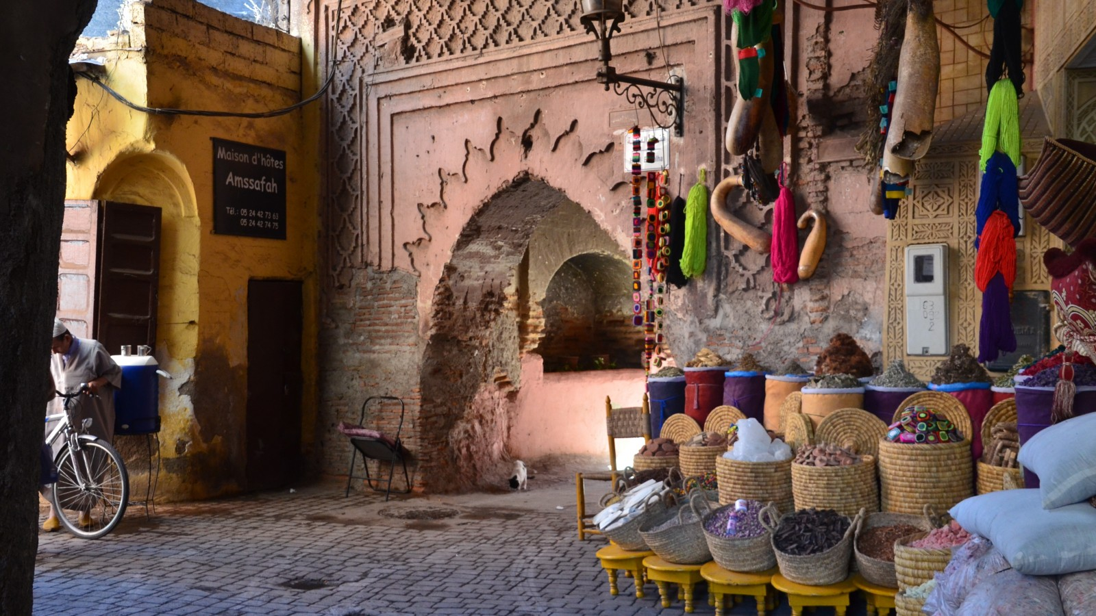 Colourful spices in sacks line the souks within Marrakech's Old Medina