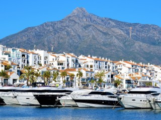 Luxury yachts lined up in the harbour of Puerto Banus, Marbella